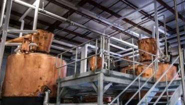 Popcorn Sutton brand rolls out new 'brown' spirits aged in oak barrels
